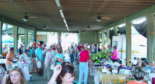 In the pavilion, with many vendors and patrons.