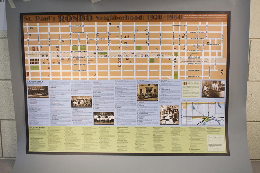 Photograph of Gerlich's poster of Rondo businesses and landmarks. The top half of the poster is a map with numbers demarcating important places. The bottom half of the poster is divided into businesses and landmarks.