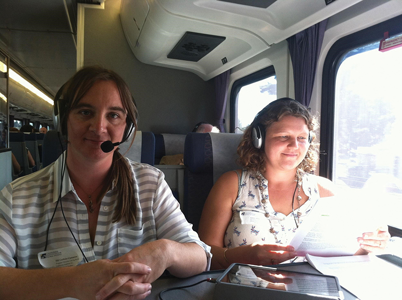 Ildi Carlisle-Cummins and Aubrey Thompson aboard an Amtrak train.