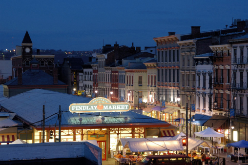 Aerial view of Findlay Market brightly lit at night.